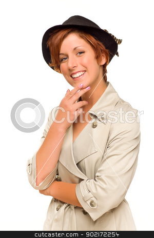 Attractive Red Haired Girl Wearing a Trench Coat and Hat stock photo, Attractive Red Haired Girl Wearing a Trenchcoat and Hat Isolated on a White Background. by Andy Dean