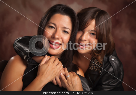 Attractive Hispanic Mother and Daughter Portrait stock photo, Attractive Hispanic Mother and Daughter Studio Portrait. by Andy Dean