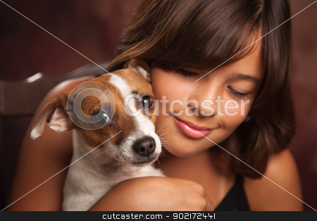 Pretty Hispanic Girl and Her Puppy Studio Portrait stock photo, Pretty Hispanic Girl and Her Jack Russell Terrier Puppy Studio Portrait. by Andy Dean