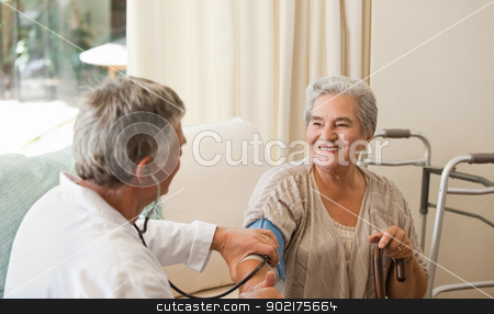 Doctor taking the blood pressure of his patient stock photo, Doctor taking the blood pressure of his patient by Wavebreak Media