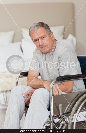 Thoughtful senior man in his wheelchair   stock photo, Thoughtful senior man in his wheelchair  at home by Wavebreak Media