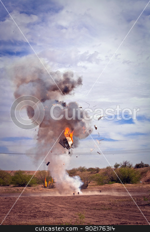 Appliance Exploded by EFX Pyrotechnic Team stock photo, Movie EFX controlled explosion of appliance in a desert by Scott Griessel