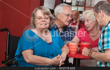 Happy Woman in Wheelchair stock photo, Joyful senior European female with friends in background by Scott Griessel