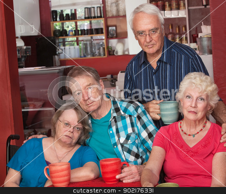 Sad Group of Senior Friends stock photo, Sad group of four senior citizens in cafe by Scott Griessel