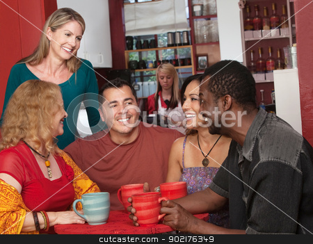 Happy Diverse Group of Adults stock photo, Smiling diverse group of mature adults in cafe by Scott Griessel