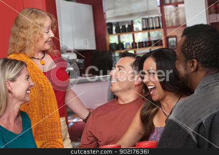 Woman Talking with Diverse Group stock photo, European lady talking with diverse group of people in a bistro by Scott Griessel