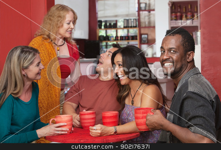 Smiling Man with Group of Friends stock photo, Smiling Black man drinking coffee with group of friends by Scott Griessel
