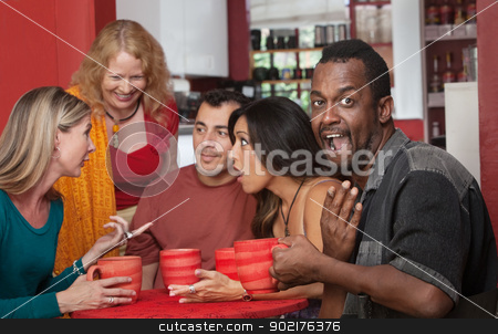 Surprised Black man with Friends stock photo, Surprised Black man with group of gossiping friends by Scott Griessel