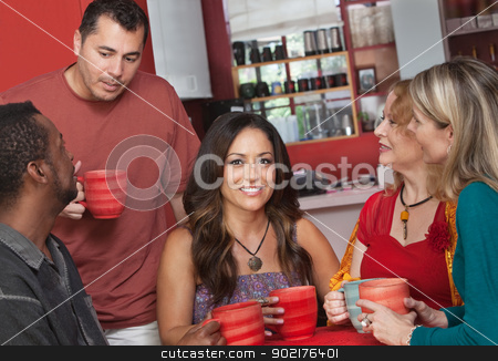 Native Woman with Friends in Cafe stock photo, Pretty Native American female with group of people in cafe by Scott Griessel