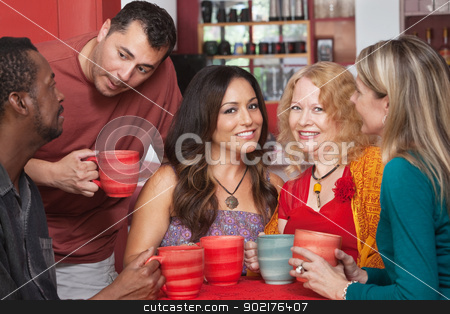 Attractive Ladies with Men in Cafe stock photo, Attractive mature women in diverse group at coffeehouse by Scott Griessel