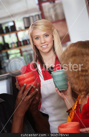Waitress with Mugs and Patrons stock photo, Smiling teenage waitress hands mugs to customers in restaurant by Scott Griessel