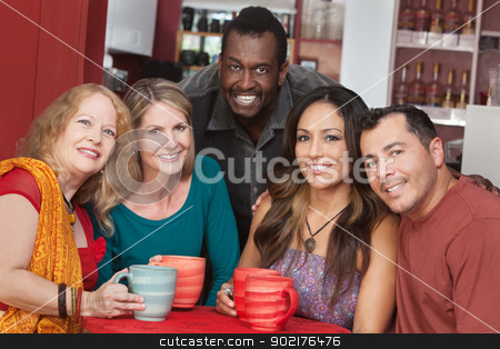 Group of Happy Mature People stock photo, Diverse group of smiling mature adults in restaurant by Scott Griessel