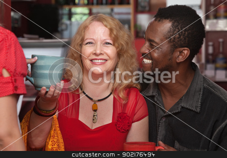 Happy Mixed Couple with Mug stock photo, Cheerful African and European couple served coffee by Scott Griessel