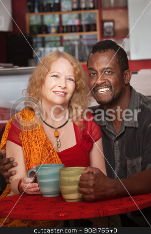 Happy Mixed Couple in Coffeehouse stock photo, Happy mixed Black and white mature couple in cafe by Scott Griessel