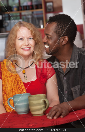 Attractive Mixed Couple in Restaurant stock photo, Attractive Black and white couple in restaurant by Scott Griessel