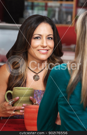 Smiling Woman with Friend in Cafe stock photo, Smiling Mexican woman with friend in cafe by Scott Griessel