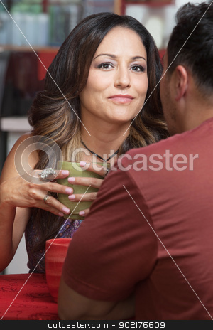 Confident Lady with Man in Cafe stock photo, Confident mature Latino woman with man at table by Scott Griessel