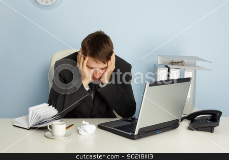 Office worker waiting for holidays stock photo, Office worker was tired and waiting for holidays by Alexey Romanov