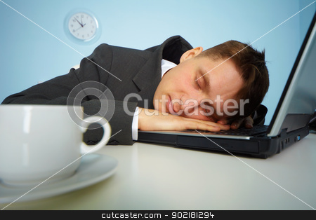 Tired man sleeping on a notebook stock photo, tired man sleeping on a notebook keyboard at night in the office  by Alexey Romanov