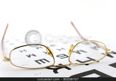 Eyeglasses on the ophthalmologic scale stock photo, Eyeglasses on the ophthalmologic scale. Shallow DOF. by Sergei Devyatkin