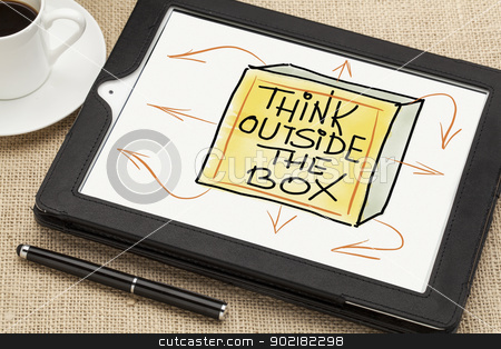 think outside the box concept stock photo, think outside the box - sketch on digital tablet  with a coffee cup and stylus pen by Marek Uliasz