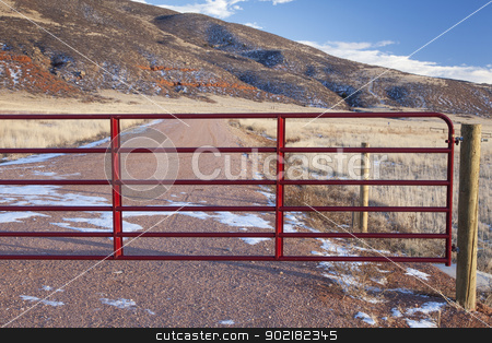 closed ranch gate stock photo, closet gate on a ranch road in a mountain valley - Red Mountain Open Space, Colorado by Marek Uliasz