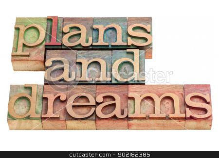 plans and dreams in wood type stock photo, plans and dreams -isolated words in vintage letterpress wood type printing blocks by Marek Uliasz