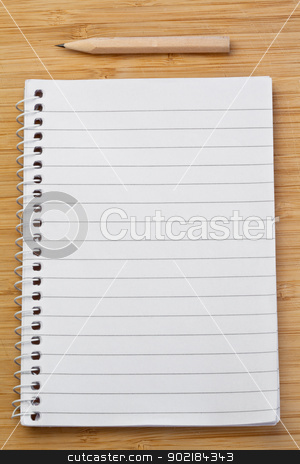 Notebook and pencil stock photo, Notebook and pen on a desk by Wavebreak Media