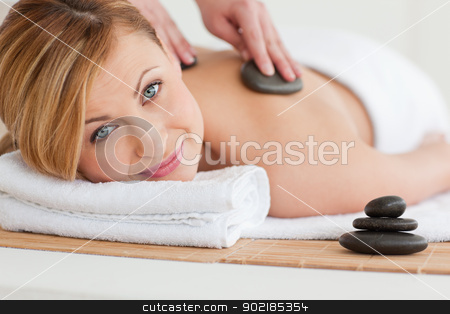 Therapist making a massage to a pretty blond-haired woman stock photo, Therapist making a massage to a pretty blond-haired woman in a spa centre by Wavebreak Media