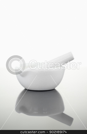 Mortar and pestle stock photo, Mortar and pestle against a white background by Wavebreak Media