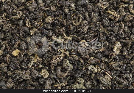 gunpowder green tea stock photo, background texture of loose leaf Chinesse gunpowder (pearl) green tea by Marek Uliasz