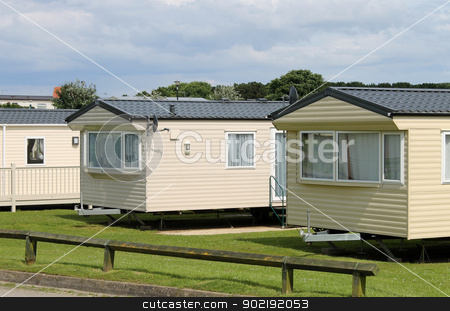 Caravan mobile homes stock photo, Caravan mobile homes in modern trailer park. by Martin Crowdy
