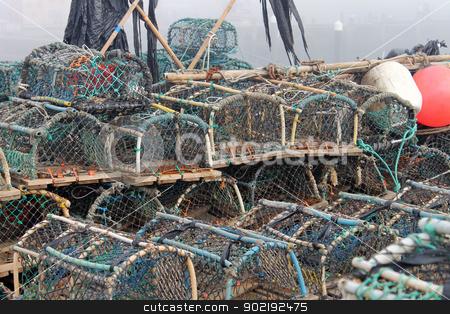 Lobster pots in harbor stock photo, Lobster pots and creels in Scarborough harbor with fog background, England. by Martin Crowdy
