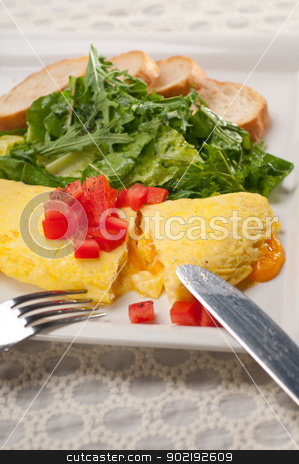 cheese ometette with tomato and salad stock photo, home made omelette with cheese tomato and rucola rocket salad arugola by Francesco Perre