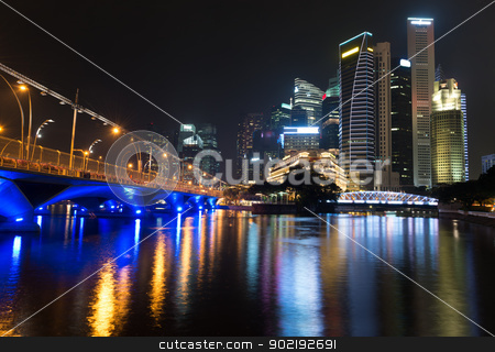 Night illuminated skyline stock photo, Night illuminated skyline view with water reflections, Singapore  by Iryna Rasko