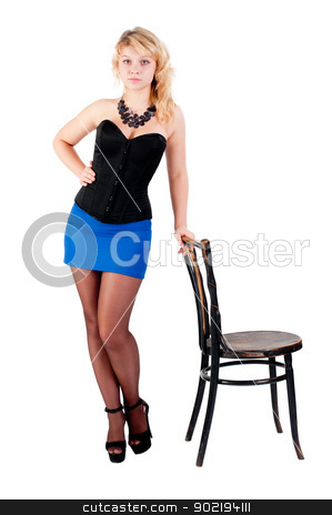 Attractive blonde woman with beads stock photo, Young pretty woman standing near chair. Isolated on white by Aikon