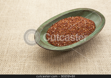 red quinoa grain stock photo, red quinoa grain in a rustic wood bowl against burlap canvas by Marek Uliasz