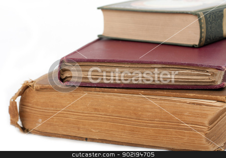 stack of antique books stock photo, Stack of antique books on isolated background by Gunter Nezhoda