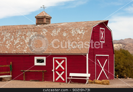 Red Barn stock photo, Old Red Barn with Bench and Well by Gunter Nezhoda