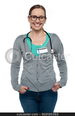 Gorgeous physician posing casually stock photo, Gorgeous physician posing casually with stethoscope around her neck. by Ishay Botbol
