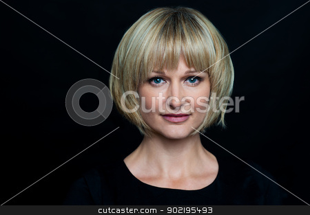 Blonde woman isolated against black background stock photo, Portrait of a middle aged blonde woman. Isolated against black background. by Ishay Botbol