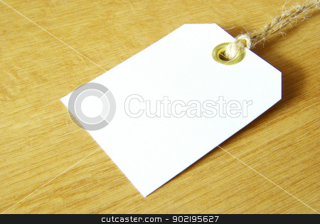 paper tags stock photo, Blank tag isolated on a wooden background by Vitaliy Pakhnyushchyy