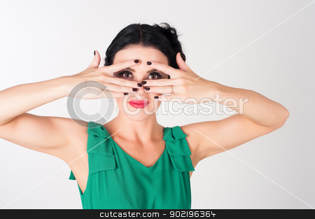 Woman covering eyes stock photo, Portrait of pretty woman cover face by hand and look by Aikon