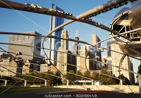 Pritzker Pavilion stock photo, Chicago, Illinois, USA - October 10, 2009  Pritzker Pavilion located in Millenium Park in downtown of Chicago. Buildings along Michigan Avenue and downtown architecture in the background. Seen during fall morning. by Henryk Sadura