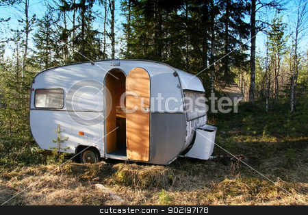 Vintage caravan  stock photo, Vintage caravan in the forest by Ingvar Bjork
