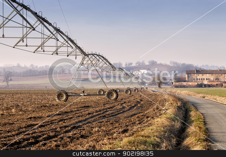 Irrigation system stock photo, Close up of irrigation system over a field by Fabio Alcini