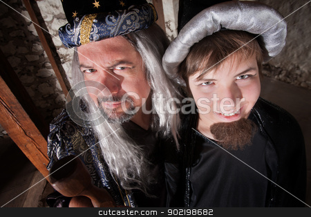 Father and Son Wizard stock photo, Caucasian father and son wizards standing next to each other by Scott Griessel