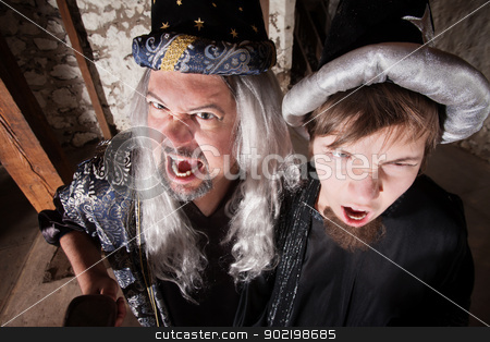 Father and Son Wizards Yelling stock photo, Caucasian father and son dressed as wizards shouting by Scott Griessel