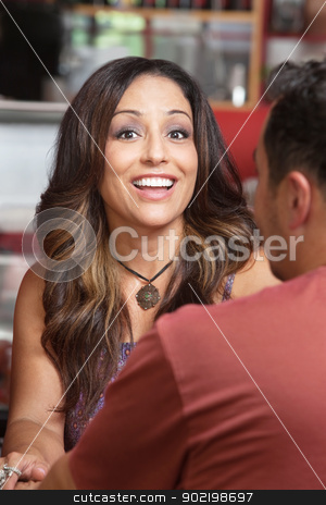 Hispanic Couple in Cafe stock photo, Joyful beautiful Native American woman with friend in bistro by Scott Griessel