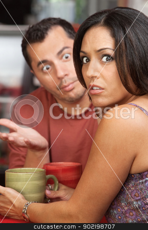 Couple Arguing in Cafe stock photo, Embarrassed woman arguing a in a restaurant with man by Scott Griessel